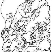 Crianças com vassouras mágicas no Dia das Bruxas