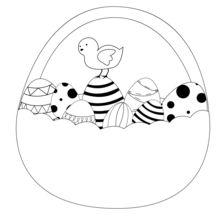Poussin e cesta de ovos de Páscoa