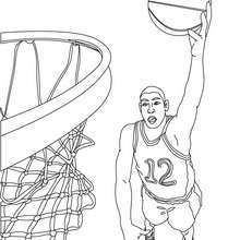 Desenho de um jogador de basquete fazendo uma bela cesta  para colorir